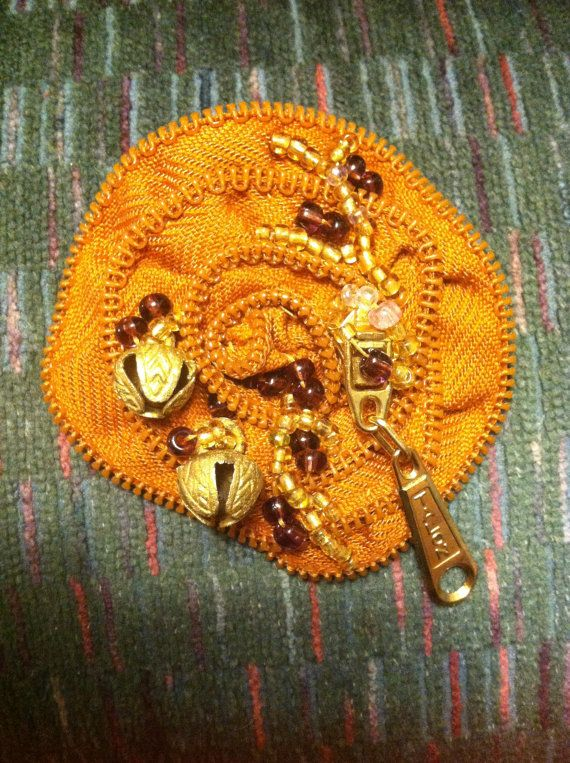 Bell zipper brooch