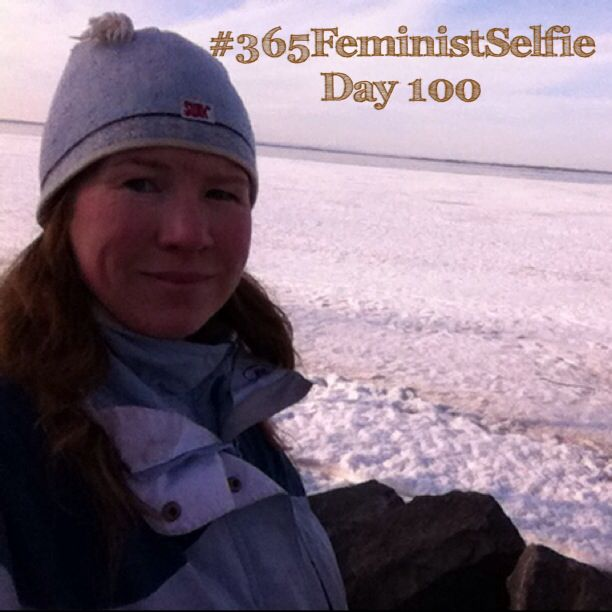 #365FeministSelfie day 100! What I have noticed: I'm more conscious of my mood. On days when I'm feeling blah, I don't want to take my selfie, and often it's days when I haven't taken my morning walk. So this morning, 100 days into 2014, the lake is frozen over again, but I'm still smiling because I took my walk and got to see that it's still frozen.