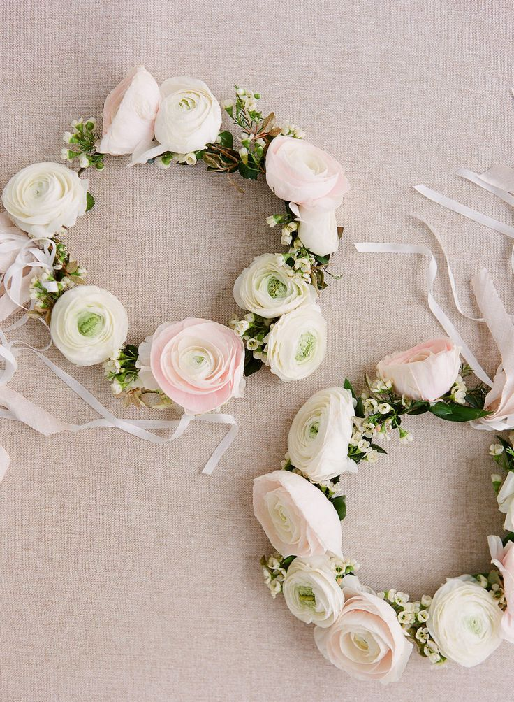 Blush and ivory ranunculus halos and flower crowns for the flower girls at this Lowndes Grove wedding | as featured in @charlestonweddings | photo: @lucycuneo | design: @calderclark | florals: @blossomsevents | venue: @pphgevents #lowndesgrove | #southernwedding #destinationwedding #luxurywedding