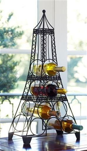 Paris Decor Eiffel Tower Wine Rack - found at:  http://www.tuscanhomedecorandmore.com/paris-decor-metal-eiffel-tower-wine-rack-burnished-black-holds-6-wine-bottles/