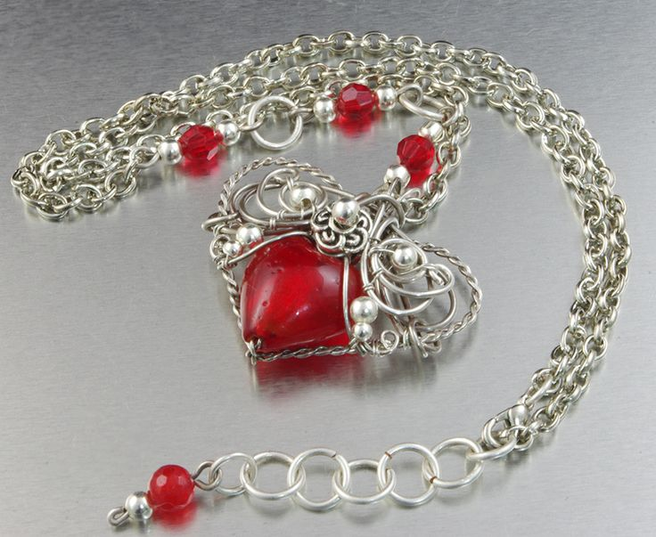 """Gorgeous silver plated pendant, with heart shaped Lampwork in a original silver braid. Beautiful, remarkable pendant, for a woman who likes unique jewelry :)  Length of the chain - 50 cm 4 cm regulation (19.69"""" 1.57""""); Pendant diameter is - 4 cm x 4 cm (1.57"""" x 1.57""""); Material: 925 sterling silver plated copper wire ; Stone: Lampwork;   On request I make a similar pendant in other material - silver, copper, brass, silver-plated copper, bronze. Interested persons are welcomed to contact :)"""