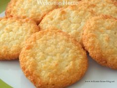 """Coconut Cookies 1 cup all-purpose flour 2 tablespoons cornstarch ½ cup powdered sugar 1 cup butter, room temperature 1 teaspoon pure vanilla 1 1/2 cups sweetened flaked coconut  325 . Line baking sheet with parchment paper. Mix flour, cornstarch and sugar in bowl. Blend butter and van  until soft dough forms. Cover, chill 1 hr Shape  ¾ inch balls, roll in coconut. Place 1-1/2""""  apt on lined sheet.  20 to 25 min , or until lightly brown"""