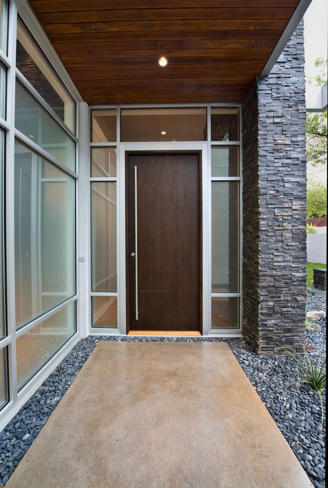 Like The Combination Of Wood And Metal Around Door, And Long Door Handle