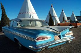 """Wigwam Village Motel 6--Route 66: In the arid Arizona desert, the Wigwam Village Motel in Holbrook still provides Route 66 aficionados the opportunity to """"Sleep in a Wigwam!"""" (Even though it's actually shaped like a tipi.)"""