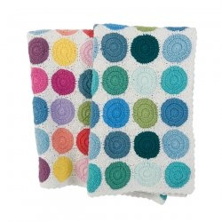 This beautiful crocheted baby blanket from Danish brand Sebra is handmade. The blanket comes in two color combination: blue and multi.