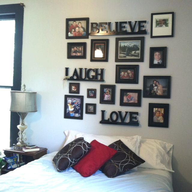 My homemade headboard...using cheap photo frames and spray painted words...everyone in my family loves staying in this room :)
