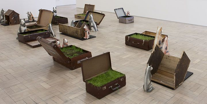 Kemang wa Lehulere. REDDENING OF THE GREENS OR DOG SLEEP MANIFESTO 2015. Suitcases, earth, grass, blackboards, salvaged school desks (wood), and ceramic dogs, dimensions variable