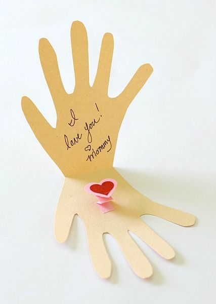 glue the pop-up heart onto your kissing hand card