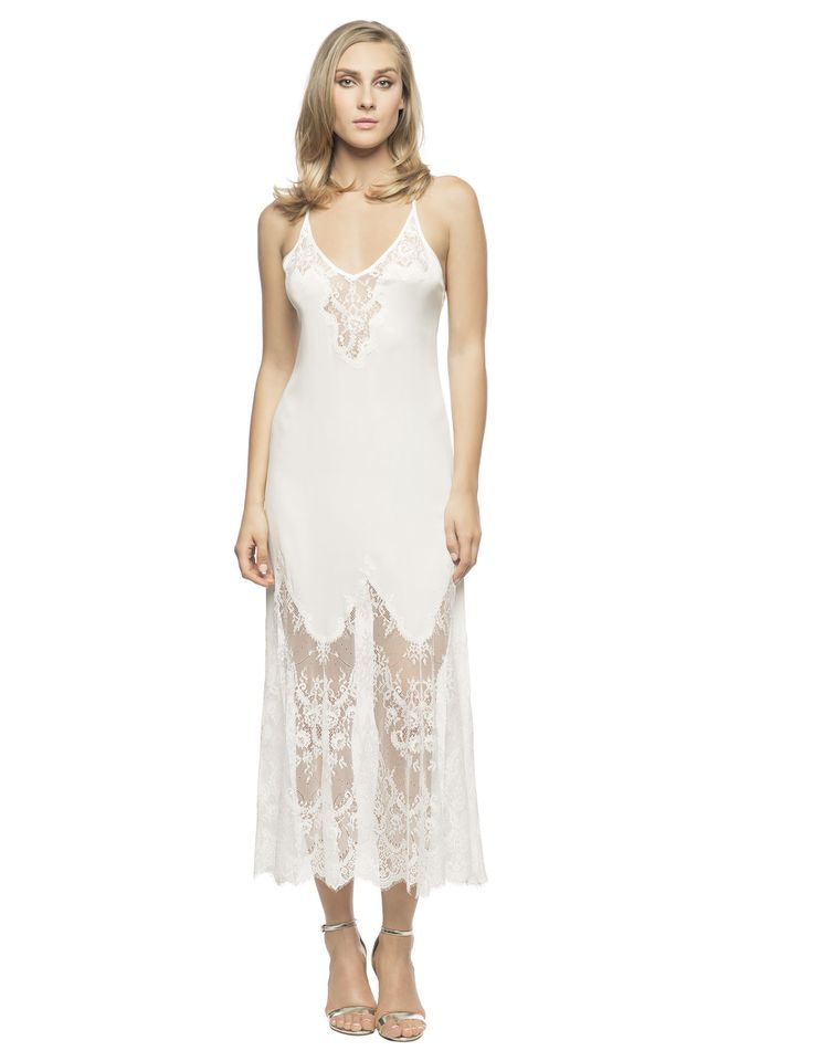 $289 Georgina Sizzling Long Slip in Ivory. Charm your way to your lover's heart sizzling long slip!  Stretch silk Georgette long gown delicately trimmed with silk charmeuse binding straps and surprising back ties, lavish lace inset neckline, mesmerizing eyelash lace mermaid skirt.