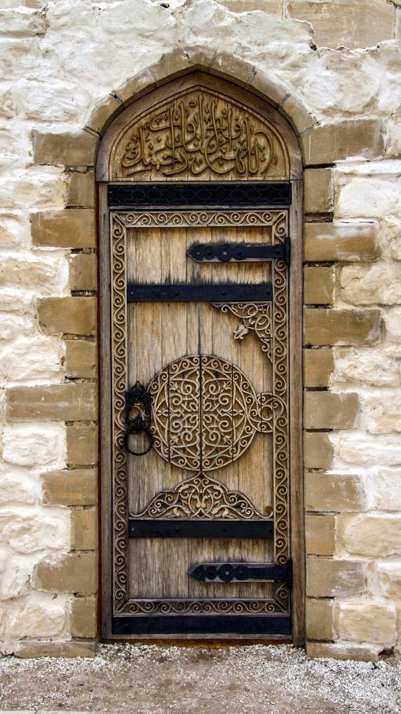 Tatarstan, Russia. Old wooden door, ornaments, brick wall, portal, entrance, doorway, details, beauty, photo