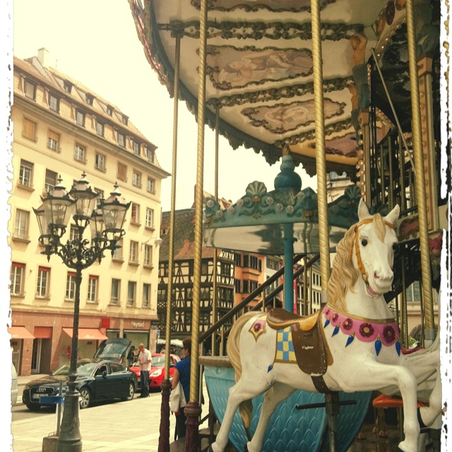 Strassbourg, France =We were here for Christmas Market and kids rode on this carousel.