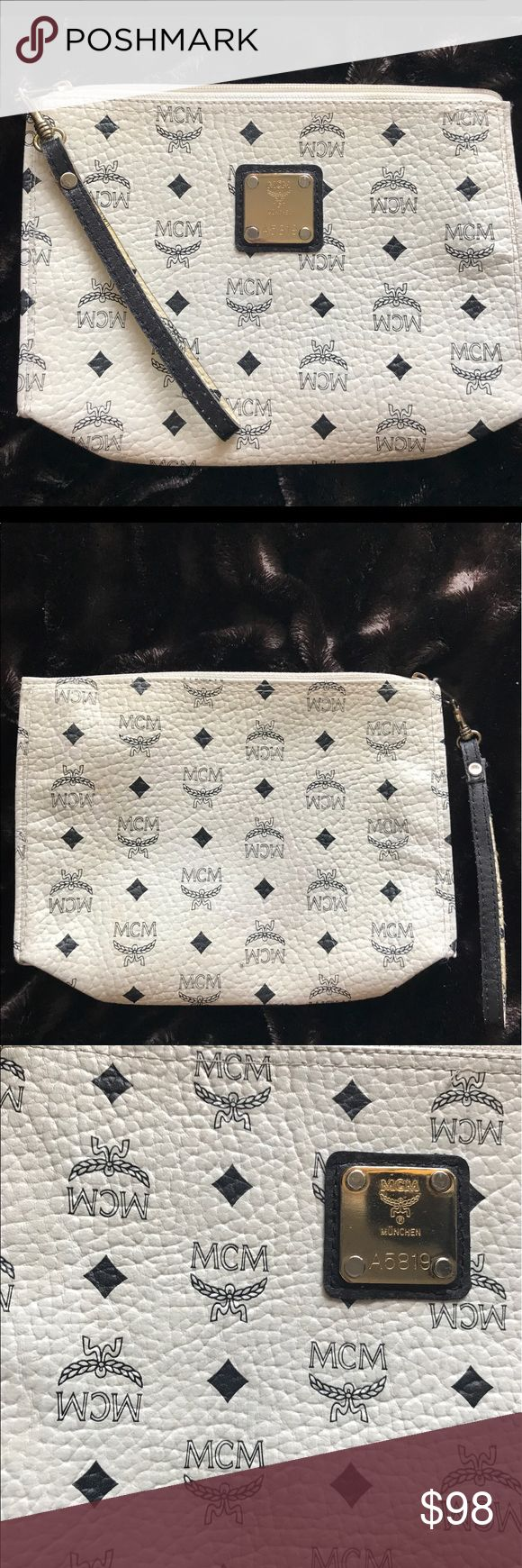 """MCM White & Navy Blue Clutch / Wristlet  💙☁️ Vintage MCM clutch! Amazing condition, from a vintage couture collector! The inside was redone to perfection and tag is not attached anymore. Perfect condition & strong zipped with adjustable (unclip) the strap for wrist or arm. Perfect for summer to spring / day to night / Casual to dressy! Will make Less $ on Ⓜ️ercari, just ask will make $80 😉 (only saying """"gucci"""" for exposure) Gucci Bags Clutches & Wristlets"""