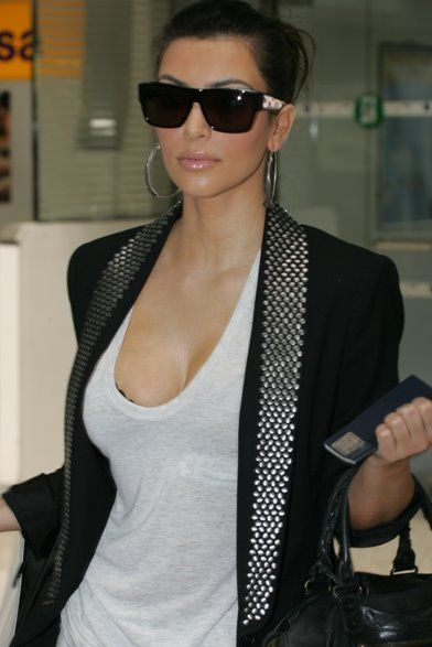 Kim Kardashian  ***The sunglasses are fly...but everything about her is fly...lol. Yeah...***