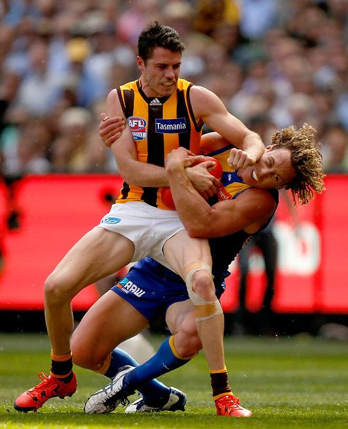 2015 Toyota AFL Grand Final - Hawthorn v West Coast -  Isaac Smith of the Hawks fends off Matt Priddis of the Eagles