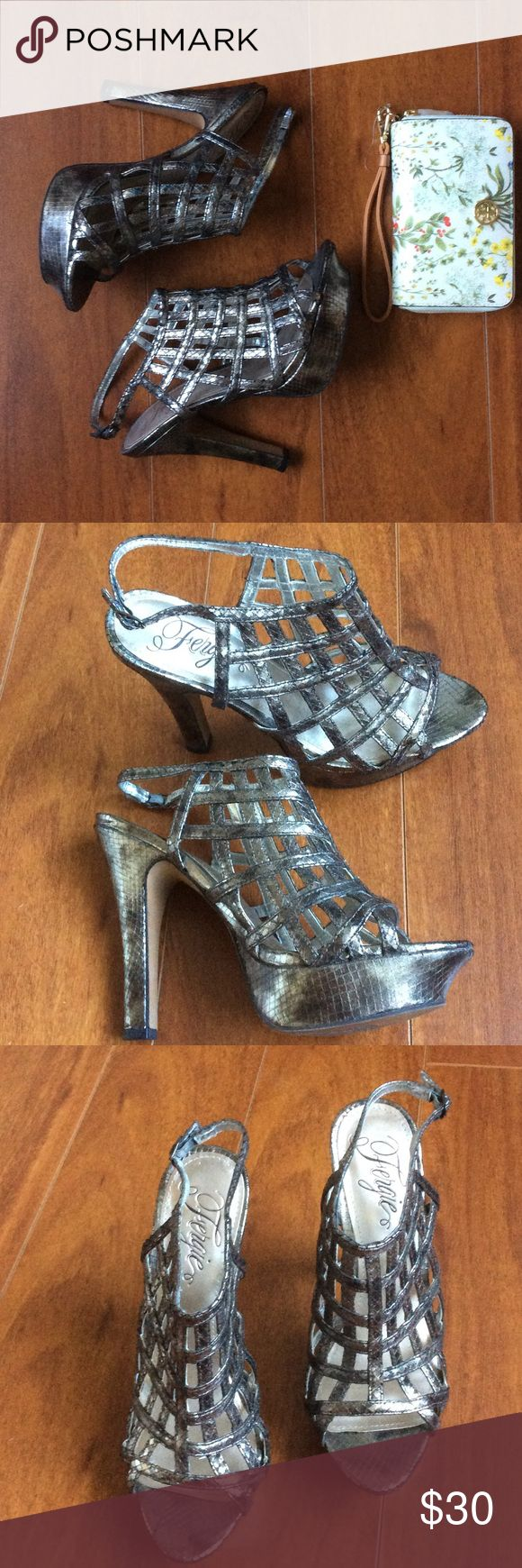 """Fergie Caged Sandal Like new Fergie Caged Sandal is a strappy design featuring a thin stacked heel, and a buckle back.  Wore once.  Heel height 5"""".  Size 8M.  Metallic slate in color. Fergie Shoes Sandals"""