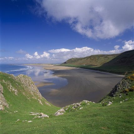 Rhossili Bay on the Gower Peninsula, South Wales   http://www.cicerone.co.uk/product/detail.cfm/book/666/title/walking-on-gower