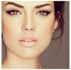 dramatic eyes with a natural glow, try Jouer Liquid Shimmer Eyeliner in Panther to create this smooth black cat eye