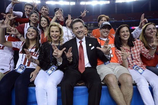 Coach Rick Pitino and his family celebrate following the Louisville Cardinals victory over Michigan in the NCAA Championship game on Monday, April 8, 2013 in Atlanta, Georgia.