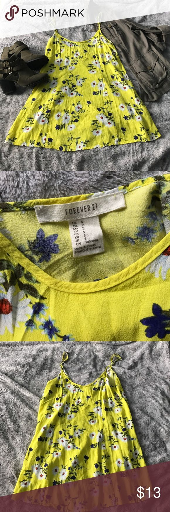 Yellow daisy Cami dress Lovely yellow daisy dress. Size small from forever 21 in great condition perfect for a nice summer day. Forever 21 Dresses Mini
