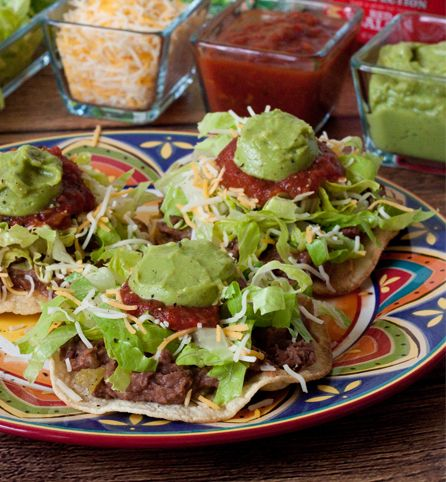 Created by: @barbarabakes: PeakFection® Guacamole and PeakFection® Red Salsa add fresh, vibrant flavor to these simple stacked tostadas.