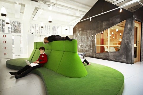 A schoolhouse in Stockholm replaces rigid classroom walls with a colorful flowing landscape of learning spaces.