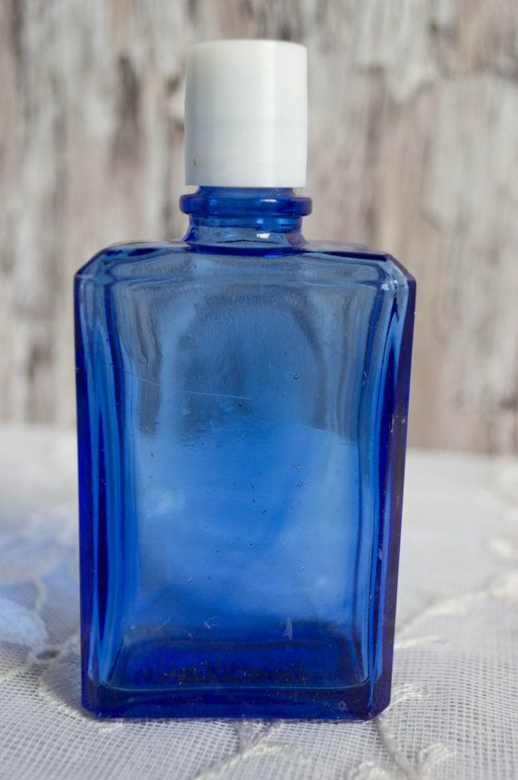 Vintage eau de cologne bottle with lid small blue glass