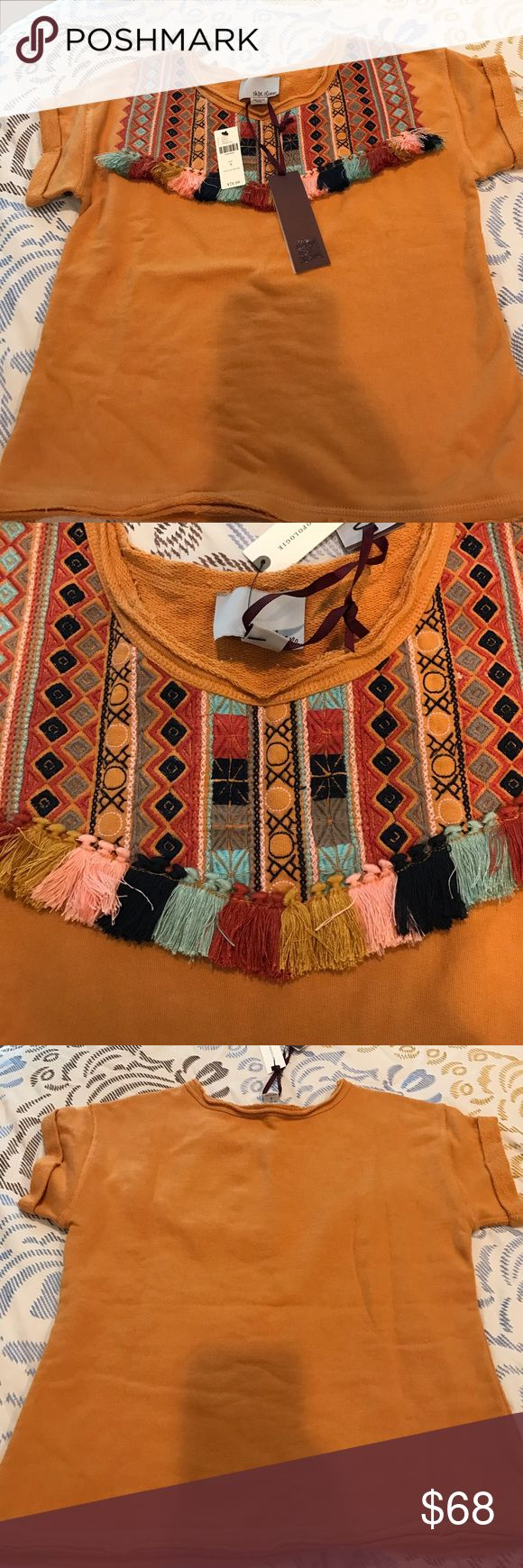 Anthropologie top Beautiful and brand-new embroidered top with fringe tassels. This top retailed for over $78! 100% cotton. No trades. Anthropologie Tops