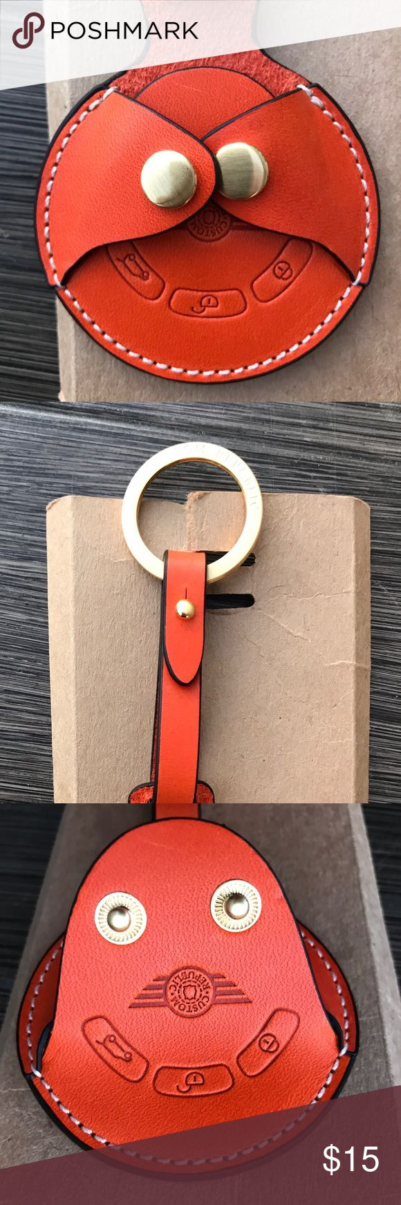 BMW Mini Cooper Key Fob Cover  NWOT Orange leather Mini Cooper key fob cover / for 2007-2014 model Mini Cooper key fobs. This is brand new with original packaging. No tags came with this. I didn't use because I ordered a cover for the wrong model....I have a 2016 model. Love the color of this and the leather is beautiful & sturdy. Mini Cooper Accessories