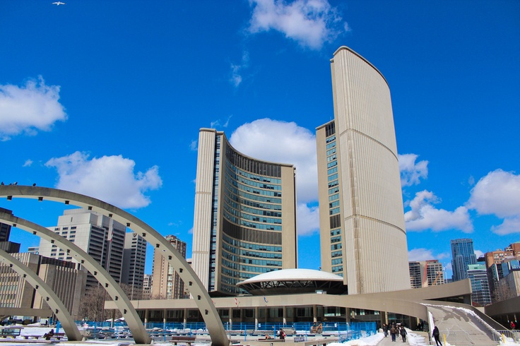 City Hall, Toronto, Ontario, Canada -  located at Nathan Phillips Square;  opened in 1965;  the east tower is 27 stories and  326 feet tall, and the west tower is 20 stories 260 feet;  between the towers is the saucer-like council chamber;  designed by Finnish architect Viljo Revell