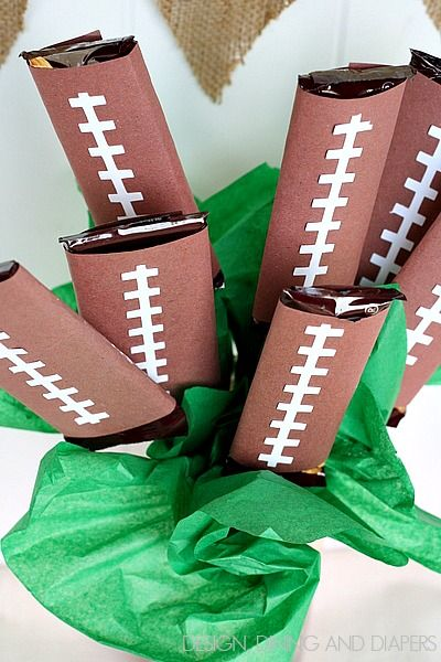 This is a must-have easy centerpiece for a football gameday gathering. Design, Dining and Diapers shares her quick tutorial for a football candy bar bouquet. Turn chocolate bars into footballs with brown and white paper and a pair of Fiskars scissors.
