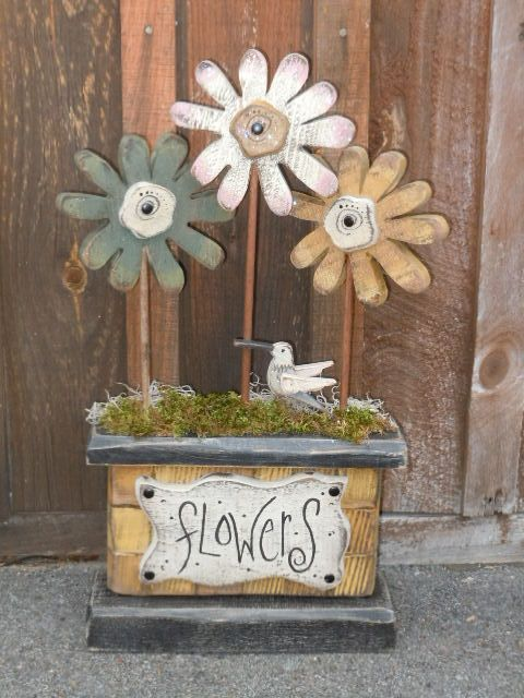 Wood flowers....love the soft primitive colors