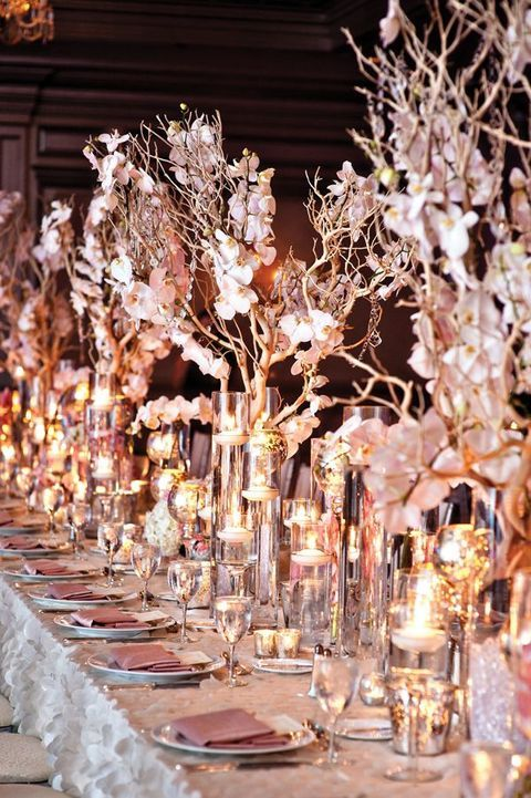 Low elegant lights and cherry blossom hues make this table setting glow.
