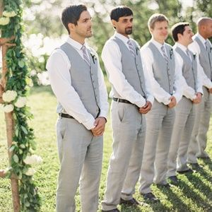 The dapper groomsmen wore gray linen pants and vests paired with purple ties from J.Crew.