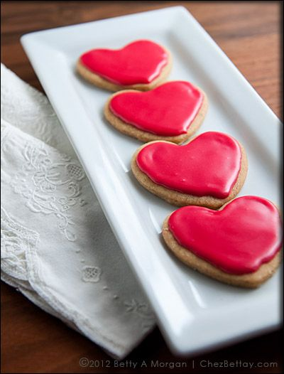 Vegan Vanilla Sugar Cookies in Heart Shapes... just in time for Valentine's Day!  Pack these in those school and work lunches all month long and hear the applause at lunch time! Don't forget a love note of encouragement with them! #veganrecipe #vegan