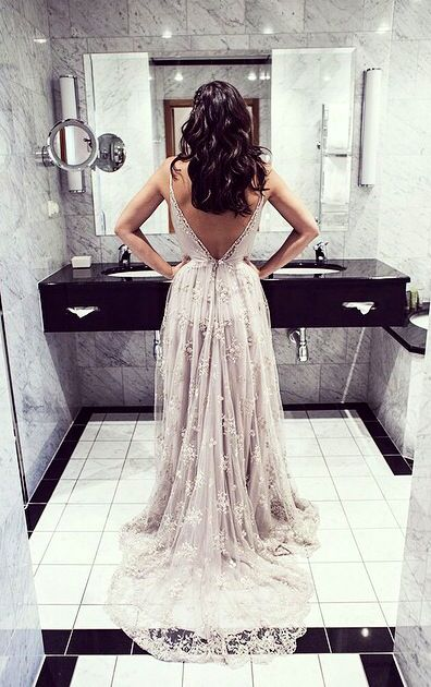 gorgeous open back wedding dress with lace train.