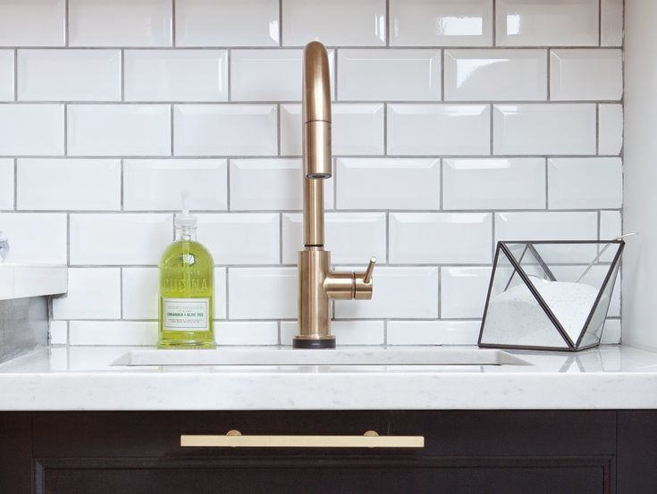 Champagne bronze finish of the Delta Trinsic facet is absolutely perfect with the gorgeous satin brass Lewis Dolin pulls from Upper Canada Specialty Hardware. A little fun with the storage for the pre-soak stain removal detergent, a black faceted geometric terrarium from West Elm.
