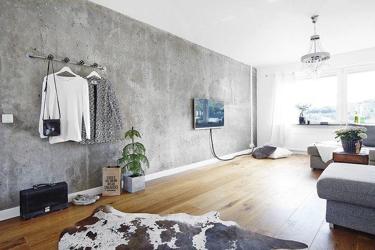 Concrete living room wall - via cocolapinedesign.com