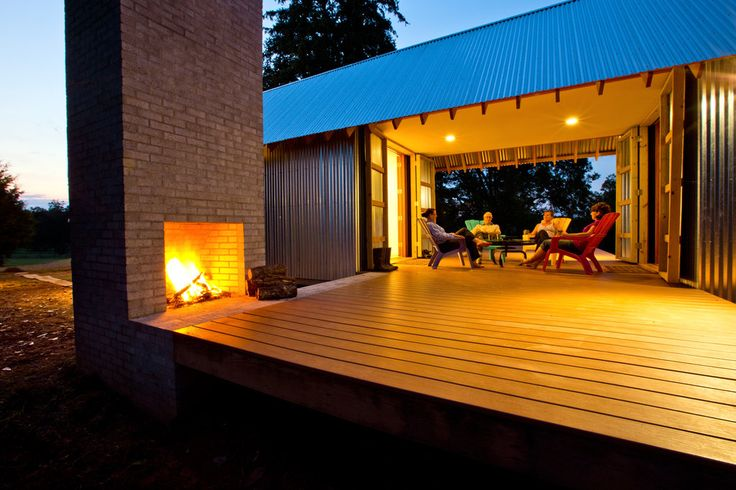 "NYTimes.com ""The house is shaped like a cross, with a deck bisecting the dog-trot style the dwelling nods to."" In Ramseur, North Carolina, a reincarnation of an original dog-trot house designed by Stephen Atkinson more than a decade ago. In love with the position of the deck, the outdoor fireplace. . . ."