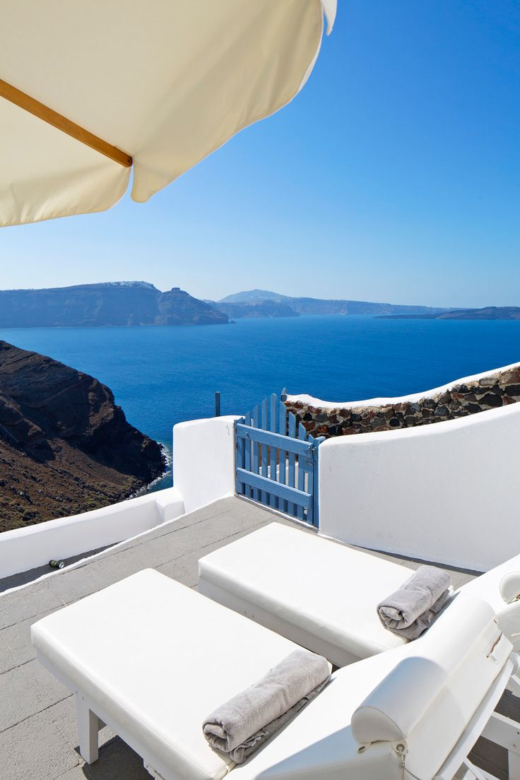 Unwind on your lounge chair and take in the lovely view at the Canaves Oia Villa