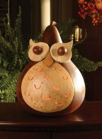 """Our wise old owl, Professor, is the perfect fall decoration. He would make a great gift, especially for a teacher.He is walnut and natural in color and comes with an electric light. He is approximately 9"""" in diameter."""