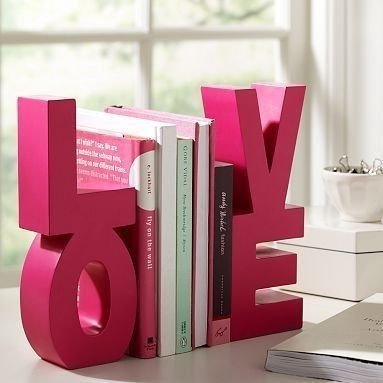 Paint and glue together block letters to use as book ends.