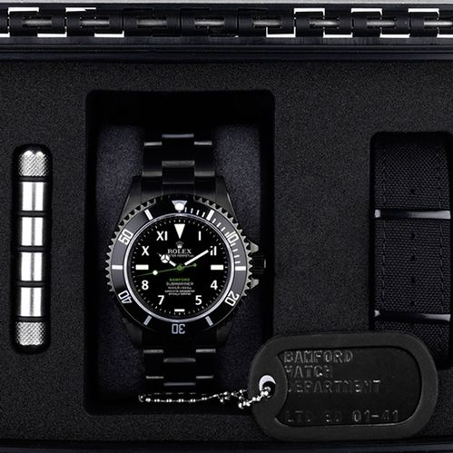 special edition all black rolex... with production dog tags... sick.