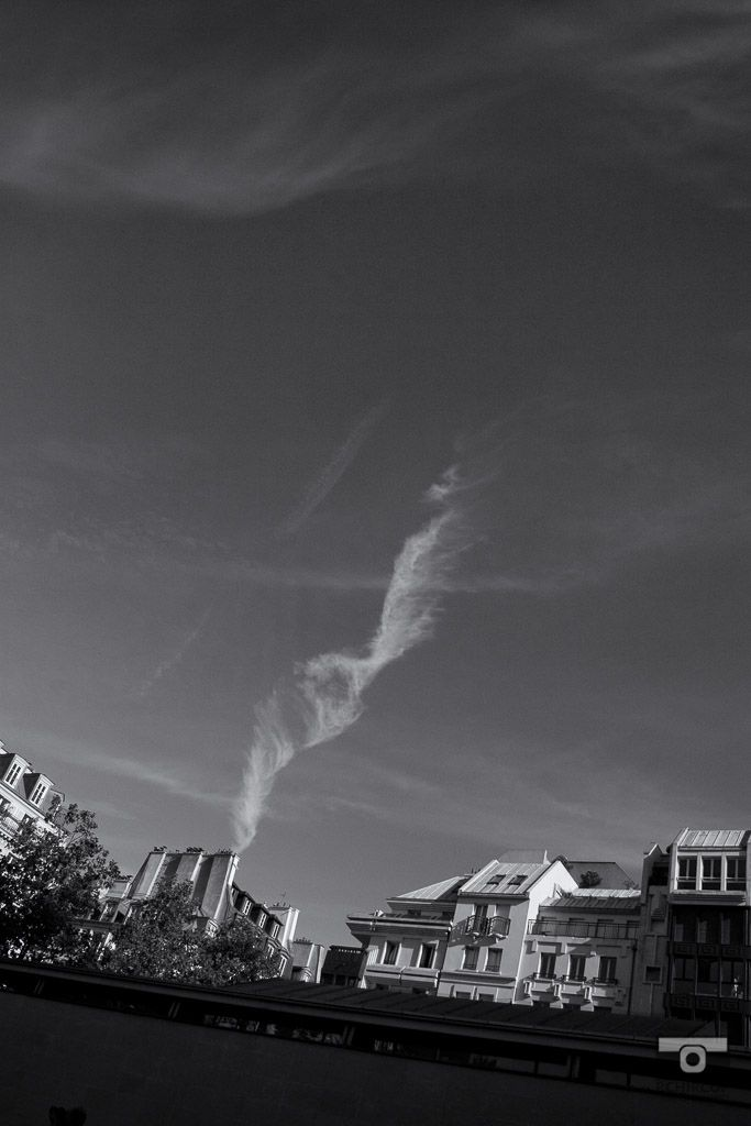 An improvised cloud formation aligned to a chimney, mémoire du paris. #Paris #France #Street Photography #Architecture #clouds #BlackandWhite