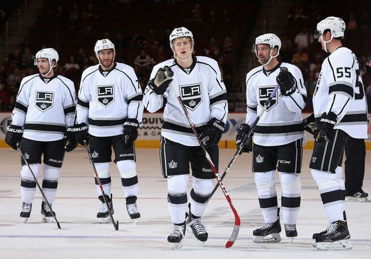 L-R) Mike Richards #10, Dwight King #74, Alex Lintuniemi #45, Justin Williams #14 and Jeff Schultz #55 of the Los Angeles Kings (22 Sept 2014)