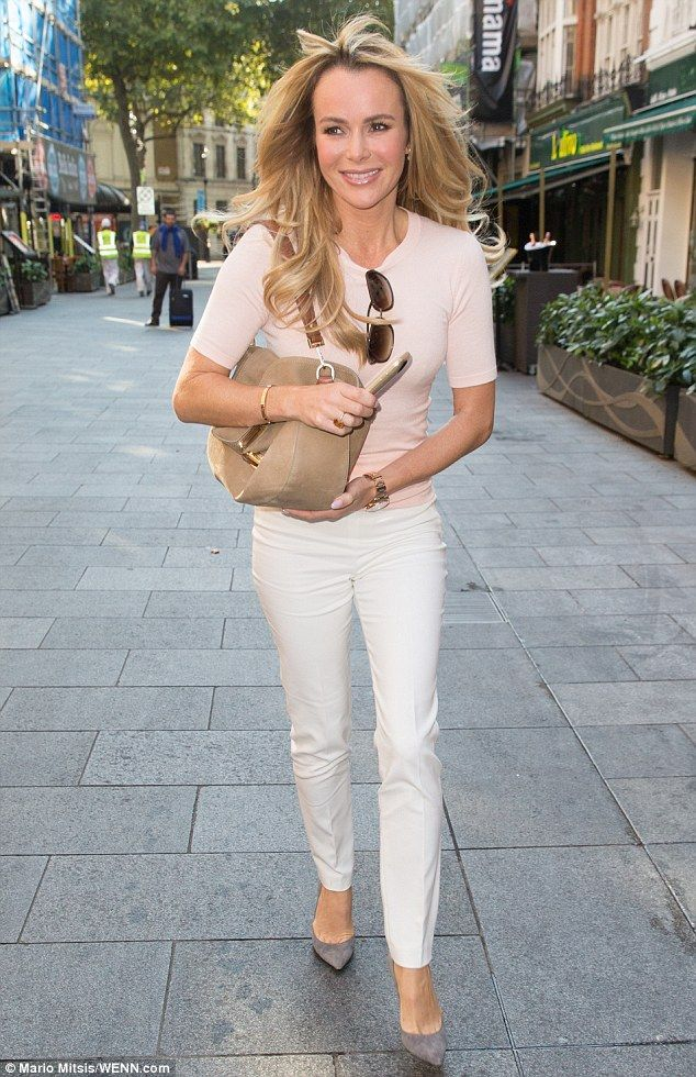 Pretty in pink: Amanda Holden showcased her effortless elegance once again as she left the Capital Radio offices in central London on Wednesday in an understated, yet chic, ensemble