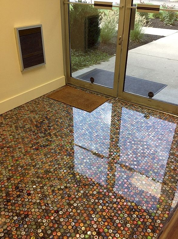 If you have a large bottle cap collection and you're looking to make your man cave truly unique, try making your very own bottle cap floor.