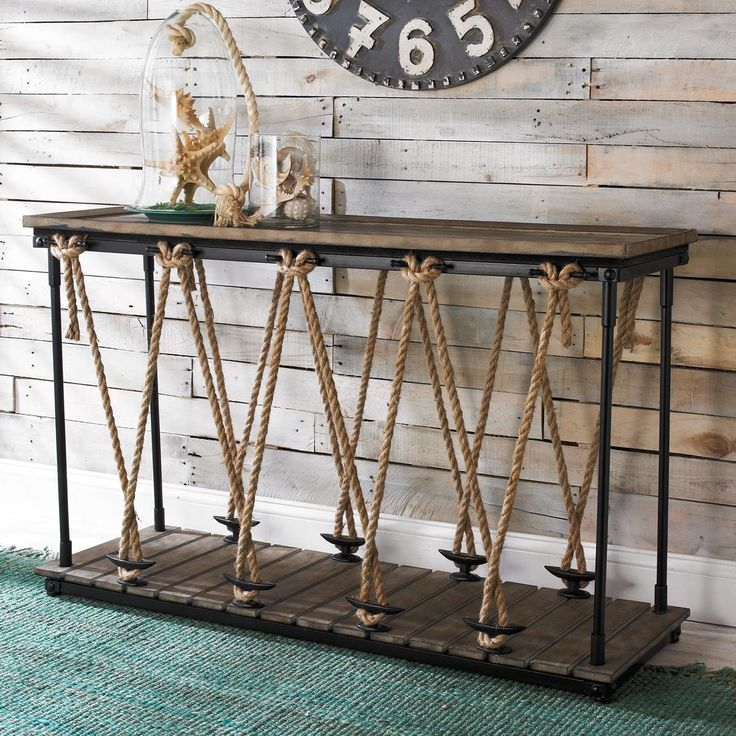 "Industrial Rope and Wood Console The clean modern lines are juxtaposed with rustic materials on this nautical inspired console table. With a slatted wood bottom and dockline details, this unique console adds reclaimed ambiance to a kitchen, entryway or office. Wood top with mahogany veneer. (32.25""H x 52""W x 17.75""D)"
