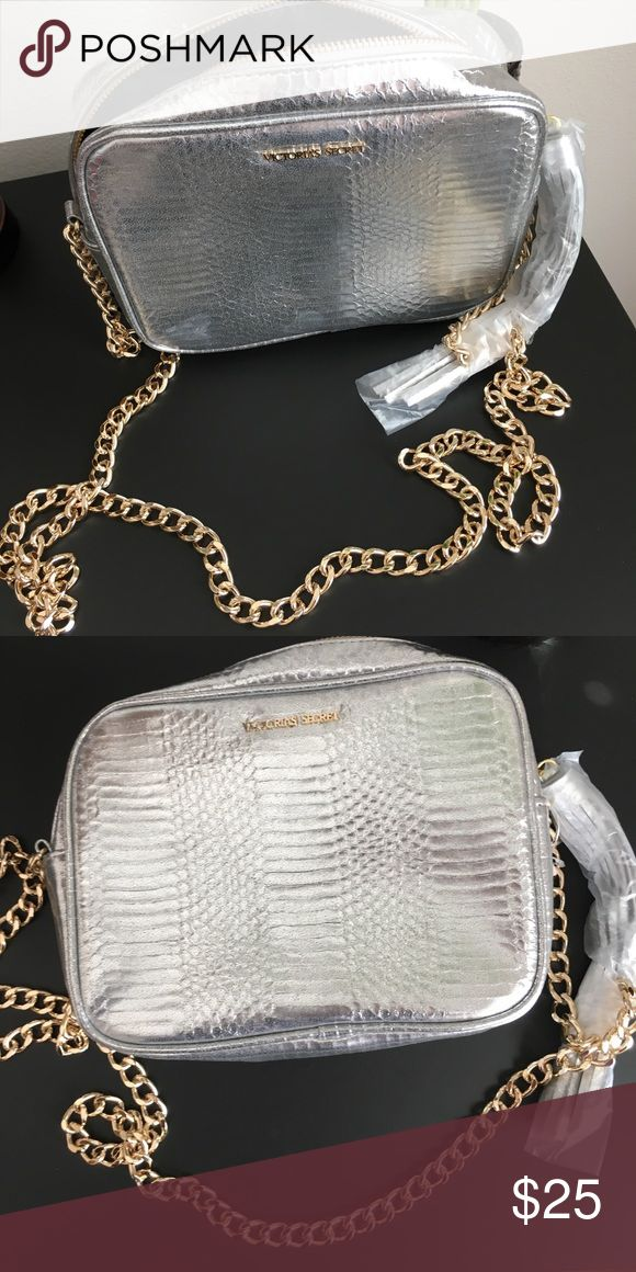 Brand new crossover bag NWT Silver crossover bag from Victoria's Secret with gold chain. Has cute tassel on zipper. Never been used Victoria's Secret Bags Crossbody Bags