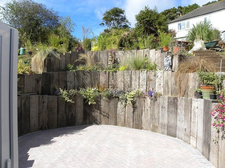 retaining wall with railway sleeper pillars