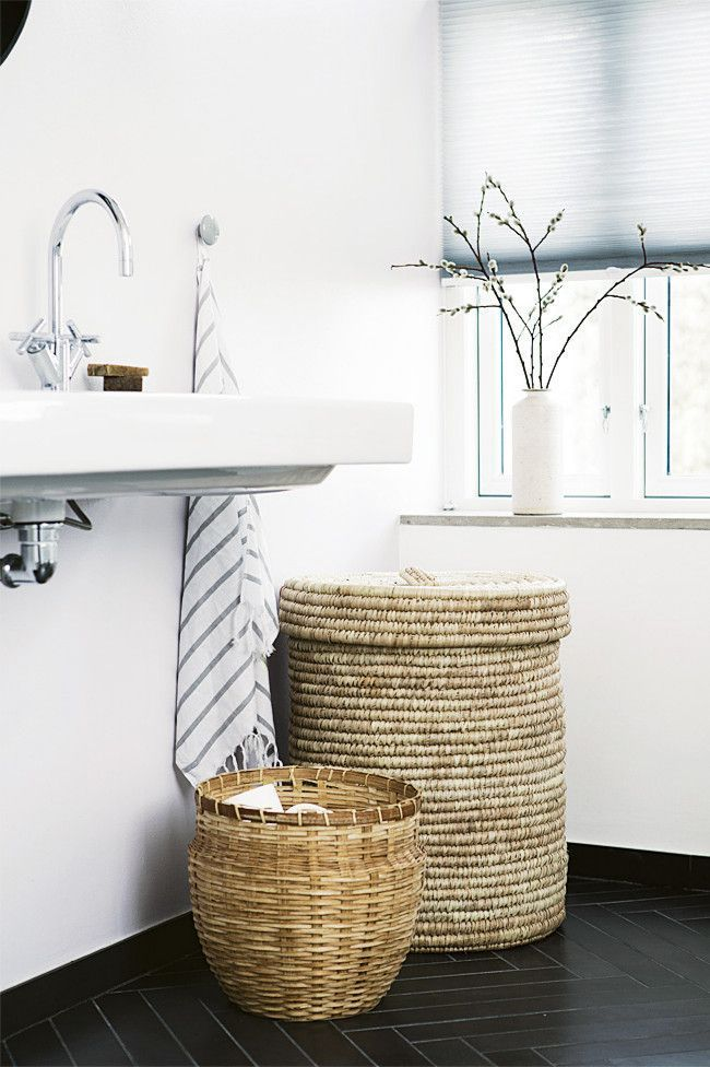Minimal and modern bathroom interior -- I like these baskets for dirty clothes or stuff like that